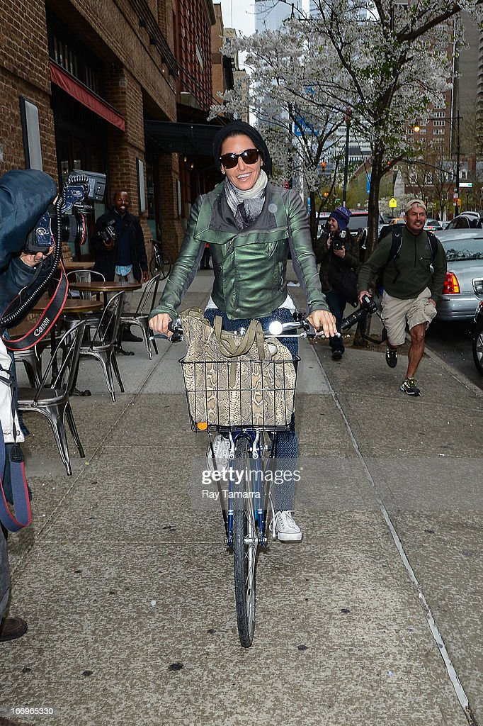Actress <a gi-track='captionPersonalityLinkClicked' href=/galleries/search?phrase=Gina+Gershon&family=editorial&specificpeople=203099 ng-click='$event.stopPropagation()'>Gina Gershon</a> rides her bike in Tribeca on April 18, 2013 in New York City.
