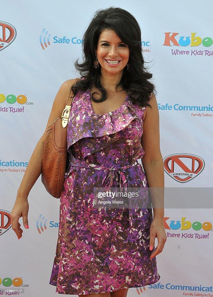 Actress Gina La Piana arrives at 'Family Day' hosted by Nick Cannon at Santa Monica Pier on October 6, 2012 in Santa Monica, California.