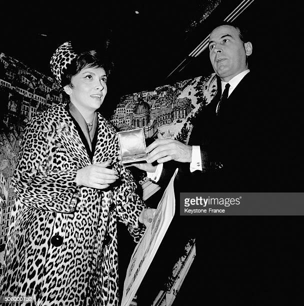 Actress Gina Lollobrigida Receives The Silver Medal Of The City Of Paris At The City Hall From The President Of Paris Municipal Council...