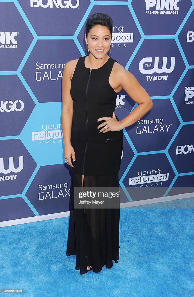 Actress <a gi-track='captionPersonalityLinkClicked' href=/galleries/search?phrase=Gina+Rodriguez+-+Actress+-+Born+1985&family=editorial&specificpeople=11423747 ng-click='$event.stopPropagation()'>Gina Rodriguez</a> arrives at the 16th Annual Young Hollywood Awards at The Wiltern on July 27, 2014 in Los Angeles, California.