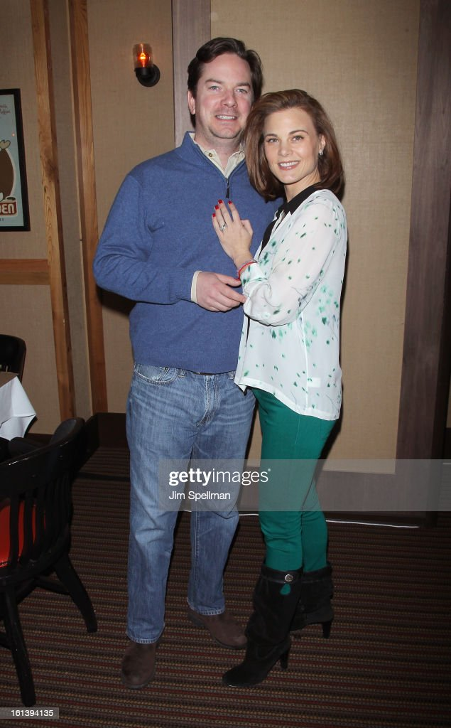 Actress <a gi-track='captionPersonalityLinkClicked' href=/galleries/search?phrase=Gina+Tognoni&family=editorial&specificpeople=592147 ng-click='$event.stopPropagation()'>Gina Tognoni</a> (R) and husband attend the 'Spontaneous Construction' premiere at Guy?s American Kitchen & Bar on February 10, 2013 in New York City.