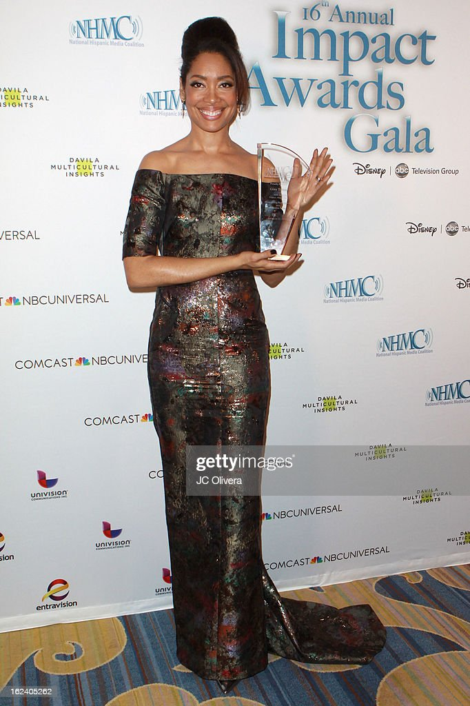 Actress Gina Torres poses with her Outstanding Performance in a Television Series Award during the National Hispanic Media Coalition's 16th Annual Impact Awards Gala at the Beverly Wilshire Four Seasons Hotel on February 22, 2013 in Beverly Hills, California.