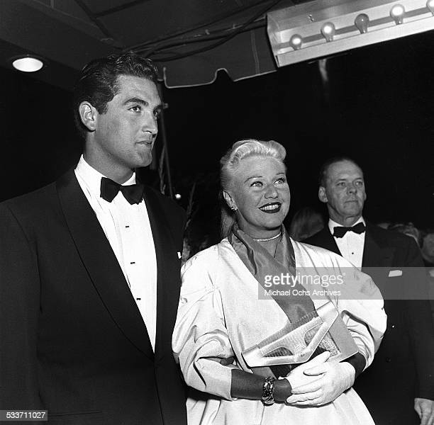 Actress Ginger Rogers and actor Jacques Bergerac attend the premiere of 'The Robe' in Los AngelesCA