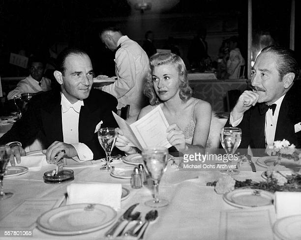 Actress Ginger Rogers and Adolphe Menjou at dinner in Los Angeles California
