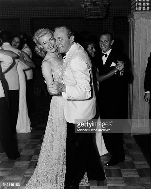 Actress Ginger Rogers dances with Jack Benny during an event in Los Angeles California