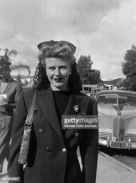 Actress Ginger Rogers poses on a street in Los Angeles California