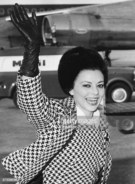Actress Giovanna Ralli wearing gloves hat and a houndstooth outfit waving as she arrives at Fiumicino Airport in Rome January 18th 1966