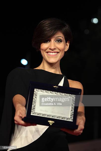 Actress Giulia Bevilacqua shows her award for thr Best Actress LARA for the movie 'Bentornato Nero Wolfe' during the 2012 RomaFictionFest at...