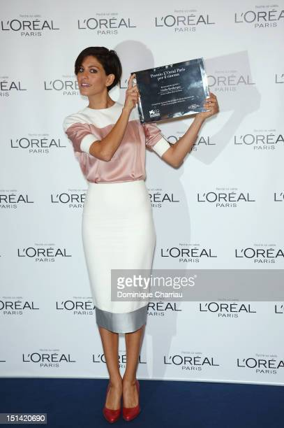 Actress Giulia Bevilacqua with her Premio L'Oreal Paris Per Il Cinema award attends Premio L'Oreal Paris Photocall during The 69th Venice Film...