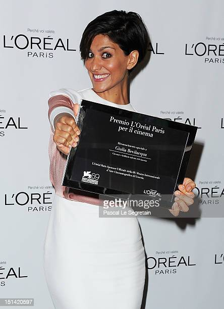 Actress Giulia Bevilacqua with the 'L'Oreal Paris Per Il Cinema' Award during the 69th Venice Film Festival on September 7 2012 in Venice Italy