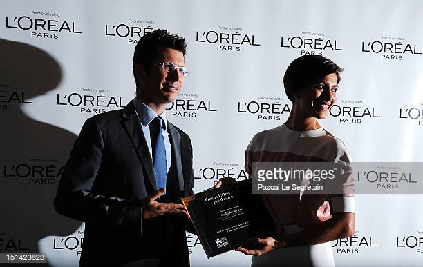 Actress Giulia Bevilacqua with the 'L'Oreal Paris Per Il Cinema' Award presented to her by L'Oreal Paris Italy Brand Director Stehane Grenier during...