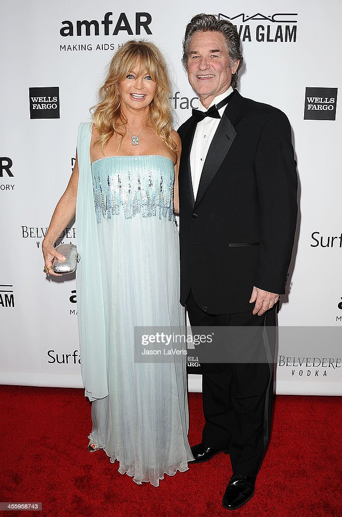 Actress Goldie Hawn and actor Kurt Russell attend the amfAR Inspiration Gala at Milk Studios on December 12, 2013 in Hollywood, California.