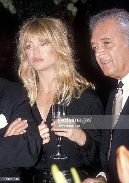 Actress Goldie Hawn and producer Martin Richards attend the 36th Annual Winter Antiques Show to Benefit the East Side House Settlement on January 19...