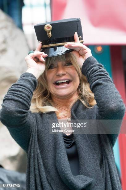 Actress Goldie Hawn jokes around during an autograph session after a press conference where Richard Lugner presented her as his guest for this year's...