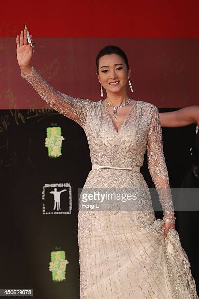 Actress Gong Li arrives for the red carpet of the 17th Shanghai International Film Festival at Shanghai Grand Theatre on June 14 2014 in Shanghai...