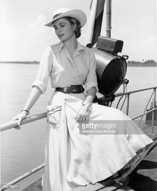 Actress Grace Kelly sits on the rail of a boat on the Magdalena river during filming of the MGM movie 'Green Fire' in 1954 in Columbia