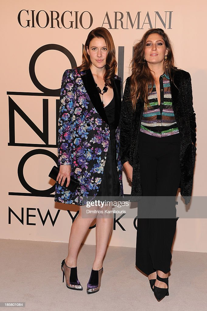 Actress Greta Gerwig, wearing Armani, (L) and Stella Schnabel attend Giorgio Armani One Night Only NYC at SuperPier on October 24, 2013 in New York City.