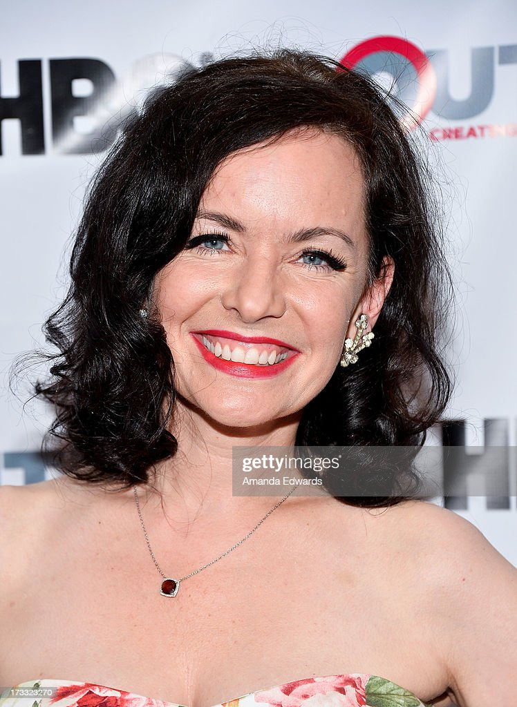 Actress Guinevere Turner arrives at the 2013 Outfest Opening Night Gala of C.O.G. at The Orpheum Theatre on July 11, 2013 in Los Angeles, California.