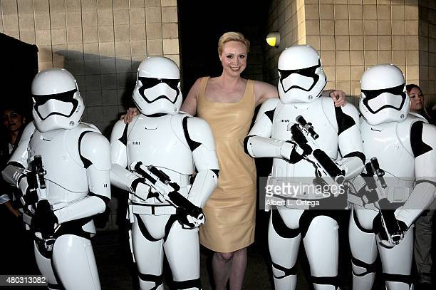 Actress Gwendoline Christie poses with Imperial Stormtroopers at the Lucasfilm panel during ComicCon International 2015 at the San Diego Convention...