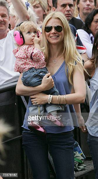 Actress Gwyneth Paltrow and daughter Apple watch Coldplay singer Chris Martin perform on stage at 'Live 8 London' in Hyde Park on July 2 2005 in...