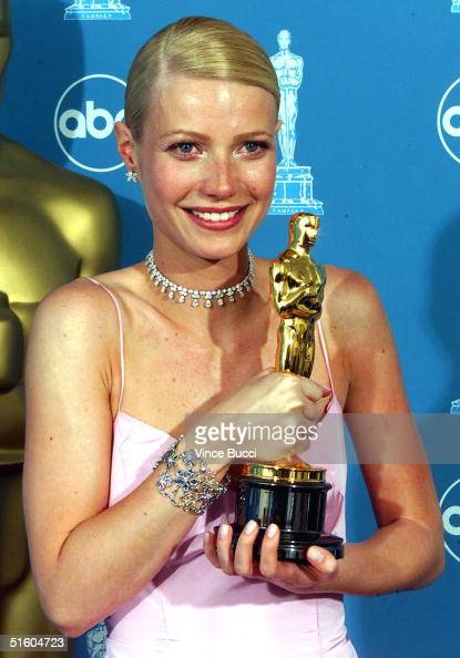 Actress Gwyneth Paltrow holds her Oscar for Best Actress for her role in 'Shakespeare in Love' at the 71st Annual Academy Awards in Los Angeles 21...