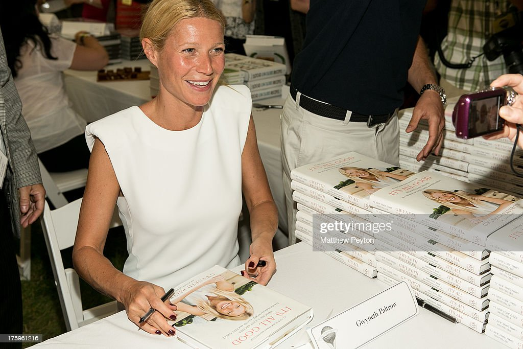 Actress <a gi-track='captionPersonalityLinkClicked' href=/galleries/search?phrase=Gwyneth+Paltrow&family=editorial&specificpeople=171431 ng-click='$event.stopPropagation()'>Gwyneth Paltrow</a> signs books during Authors Night For The East Hampton Library at Gardiner's Farm on August 10, 2013 in East Hampton, New York.