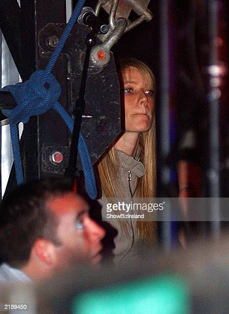 Actress Gwyneth Paltrow watches her boyfriend Chris Martin of ColdPlay perform at the Guinness Witnness Festival at Punchestown Racecourse July 12...