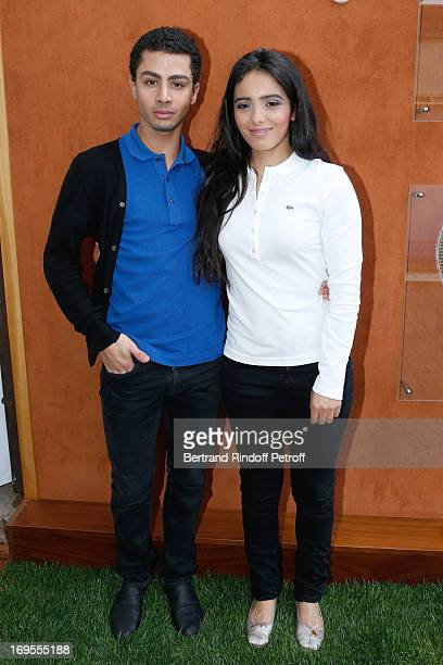 Actress Hafsia Herzi and her brother actor Djanis Bouzyani attend Roland Garros Tennis French Open 2013 Day 2 on May 27 2013 in Paris France