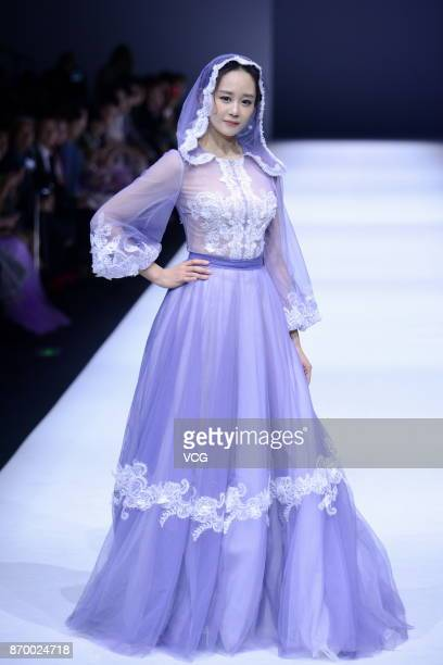 Actress Hai Lu showcases designs on the runway at Aolisha collection by designer Wei Xinkun during the MercedesBenz China Fashion Week Spring/Summer...
