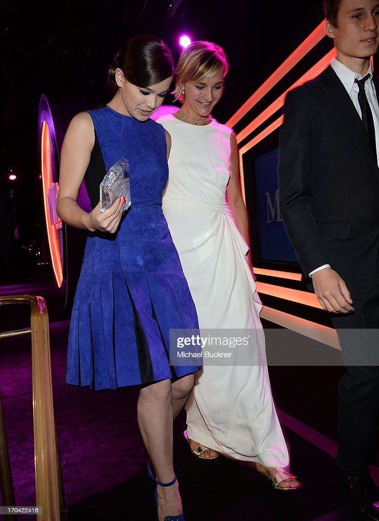 Actress Hailee Steinfeld (L) and Max Mara executive Nicola Maramotti attend Women In Film's 2013 Crystal + Lucy Awards at The Beverly Hilton Hotel on June 12, 2013 in Beverly Hills, California.