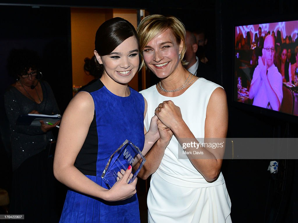 Actress Hailee Steinfeld (left, holding the 2013 Women In Film Max Mara Face of the Future Award) and Max Mara executive Nicola Maramotti pose backstage at Women In Film's 2013 Crystal + Lucy Awards at The Beverly Hilton Hotel on June 12, 2013 in Beverly Hills, California.
