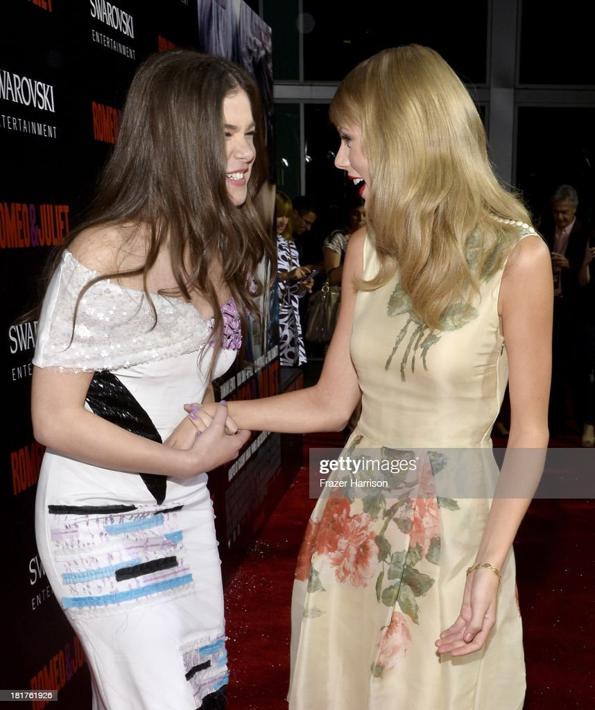 Actress <a gi-track='captionPersonalityLinkClicked' href=/galleries/search?phrase=Hailee+Steinfeld&family=editorial&specificpeople=7223409 ng-click='$event.stopPropagation()'>Hailee Steinfeld</a> (L) and singer <a gi-track='captionPersonalityLinkClicked' href=/galleries/search?phrase=Taylor+Swift&family=editorial&specificpeople=619504 ng-click='$event.stopPropagation()'>Taylor Swift</a> arrive at the premiere of Relativity Media's 'Romeo And Juliet' at ArcLight Cinemas on September 24, 2013 in Hollywood, California.