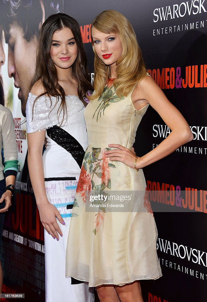Actress Hailee Steinfeld (L) and singer Taylor Swift arrive at the world premiere of 'Romeo and Juliet' at the ArcLight Hollywood on September 24, 2013 in Hollywood, California.