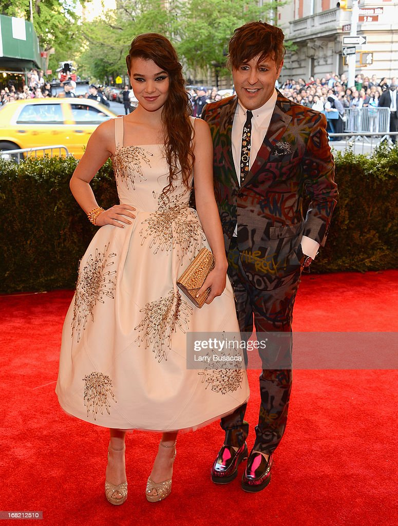 Actress Hailee Steinfeld and Teen Vogue editor Andrew Bevan attend the Costume Institute Gala for the 'PUNK: Chaos to Couture' exhibition at the Metropolitan Museum of Art on May 6, 2013 in New York City.