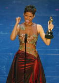 US actress Halle Berry accepts her Oscar for best performance by an actress in a leading role for 'Monster's Ball' during the 74th Academy Awards at...