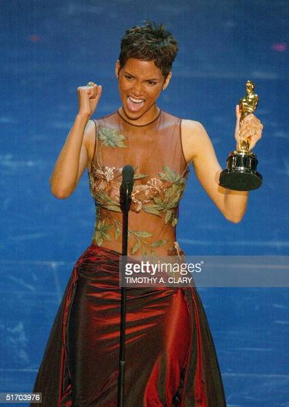 Us actress halle berry accepts her oscar for best performance by an