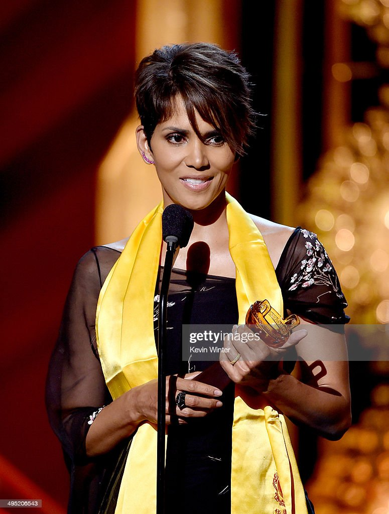 Actress <a gi-track='captionPersonalityLinkClicked' href=/galleries/search?phrase=Halle+Berry&family=editorial&specificpeople=201726 ng-click='$event.stopPropagation()'>Halle Berry</a> accepts the Global Movie Icon Award onstage at the 2014 Huading Film Awards at The Montalban Theatre on June 1, 2014 in Los Angeles, California.