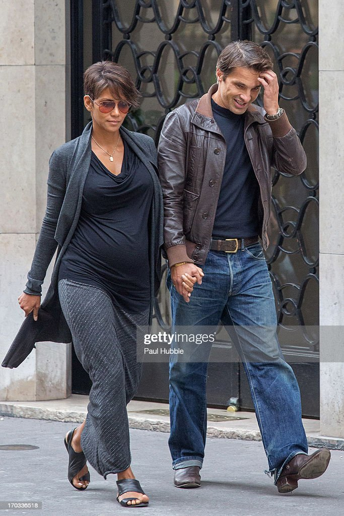 Actress <a gi-track='captionPersonalityLinkClicked' href=/galleries/search?phrase=Halle+Berry&family=editorial&specificpeople=201726 ng-click='$event.stopPropagation()'>Halle Berry</a> and actor <a gi-track='captionPersonalityLinkClicked' href=/galleries/search?phrase=Olivier+Martinez&family=editorial&specificpeople=213013 ng-click='$event.stopPropagation()'>Olivier Martinez</a> are seen on the 'Rue Clement Marot' on June 11, 2013 in Paris, France.