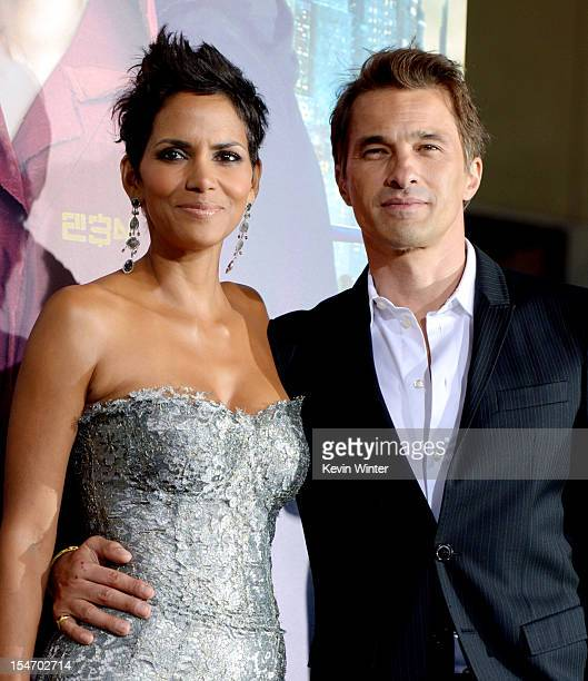 Actress Halle Berry and actor Olivier Martinez arrive at the premiere of Warner Bros Pictures' 'Cloud Atlas' at the Chinese Theatre on October 24...