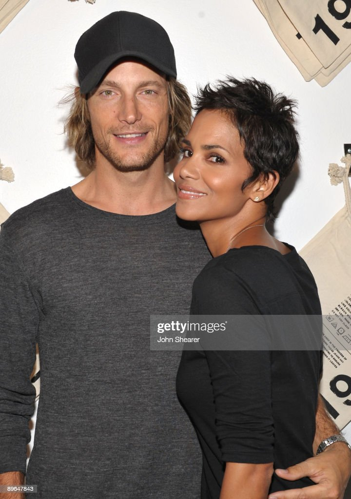 Actress Halle Berry and Gabriel Aubry attend the launch event for Gap's 1969 Jean Shop on Robertson Blvd at their 1969 Jean Shop on August 6 2009 in...
