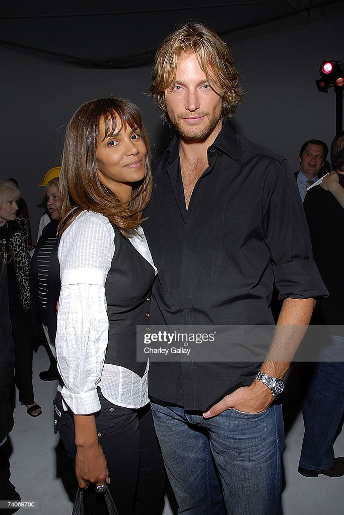 Actress <a gi-track='captionPersonalityLinkClicked' href=/galleries/search?phrase=Halle+Berry&family=editorial&specificpeople=201726 ng-click='$event.stopPropagation()'>Halle Berry</a> (L) and Gabriel Aubry attend the party for Laura Meyer and Robyn Roth's new book 'Remodel This! A Woman's Guide to Planning and Surviving the Madness of a Home Renovation' at Miauhaus Studios on May 3, 2007 in Los Angeles, California.