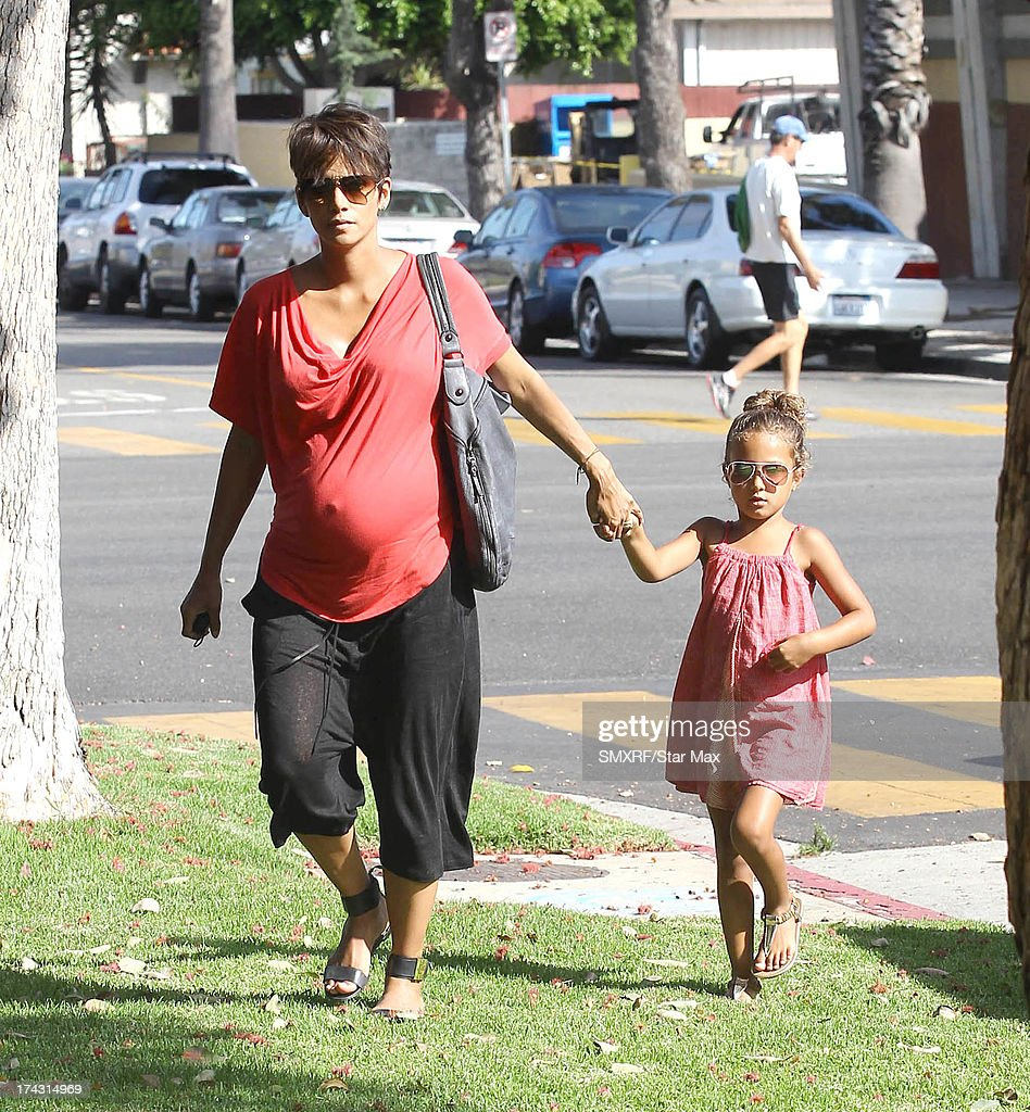 Actress <a gi-track='captionPersonalityLinkClicked' href=/galleries/search?phrase=Halle+Berry&family=editorial&specificpeople=201726 ng-click='$event.stopPropagation()'>Halle Berry</a> and her daughter Nahla Ariela Aubry as seen on July 23, 2013 in Los Angeles, California.