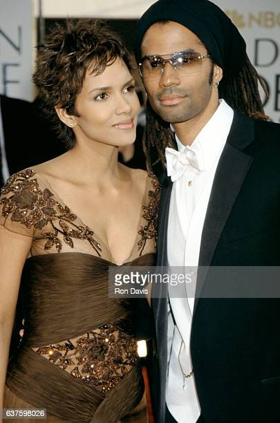 Actress Halle Berry and her husband musician Eric Benet attend the 59th Annual Golden Globe Awards at the Beverly Hilton Hotel on January 20 2002 in...