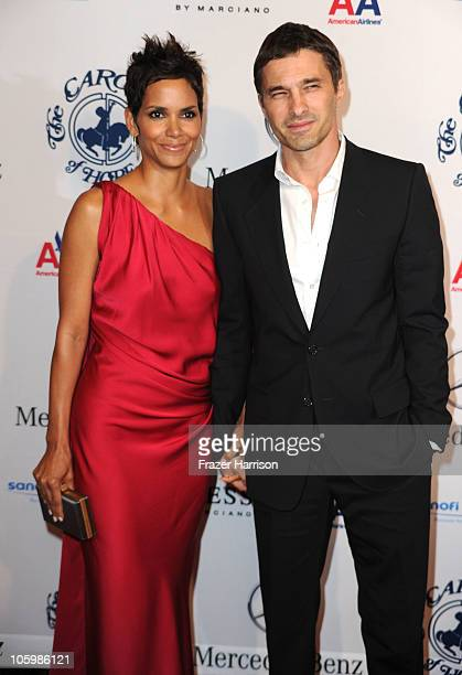 Actress Halle Berry and Olivier Martinez arrive at the 32nd Anniversary Carousel Of Hope Gala at the Beverly Hilton Hotel on October 23 2010 in...
