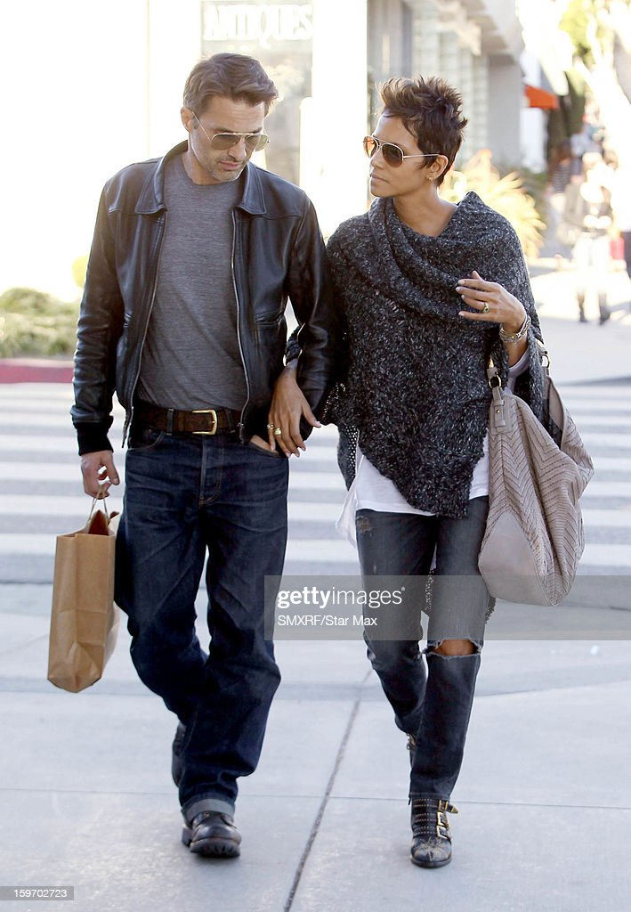 Actress <a gi-track='captionPersonalityLinkClicked' href=/galleries/search?phrase=Halle+Berry&family=editorial&specificpeople=201726 ng-click='$event.stopPropagation()'>Halle Berry</a> and <a gi-track='captionPersonalityLinkClicked' href=/galleries/search?phrase=Olivier+Martinez&family=editorial&specificpeople=213013 ng-click='$event.stopPropagation()'>Olivier Martinez</a> as seen on January 18, 2013 in Los Angeles, California.