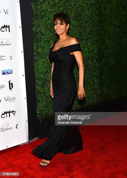 Actress Halle Berry arrives at the Fame Philanthropy PostOscar Party benefiting The Community Inspiring Today's Youth Charlize Theron Africa Outreach...