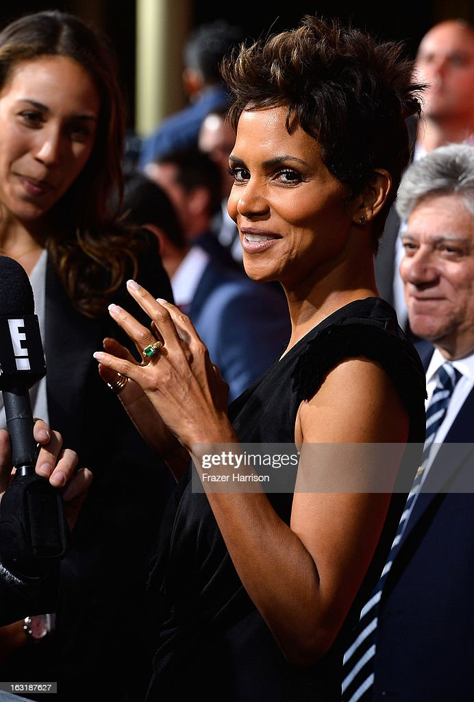 Actress <a gi-track='captionPersonalityLinkClicked' href=/galleries/search?phrase=Halle+Berry&family=editorial&specificpeople=201726 ng-click='$event.stopPropagation()'>Halle Berry</a> arrives at the premiere of Tri Star Pictures' 'The Call' at ArcLight Cinemas on March 5, 2013 in Hollywood, California.