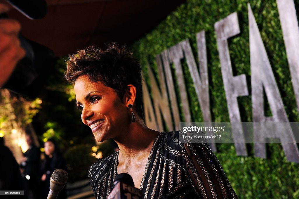 Actress Halle Berry arrives for the 2013 Vanity Fair Oscar Party hosted by Graydon Carter at Sunset Tower on February 24, 2013 in West Hollywood, California.