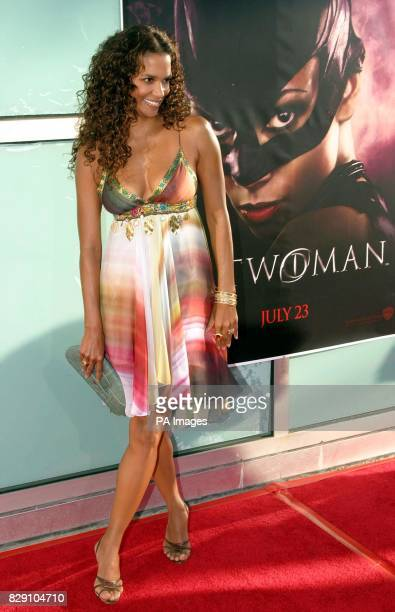Actress Halle Berry arrives for the premiere of her latest film Catwoman held at the Cinerama Dome Theatre Los Angeles USA