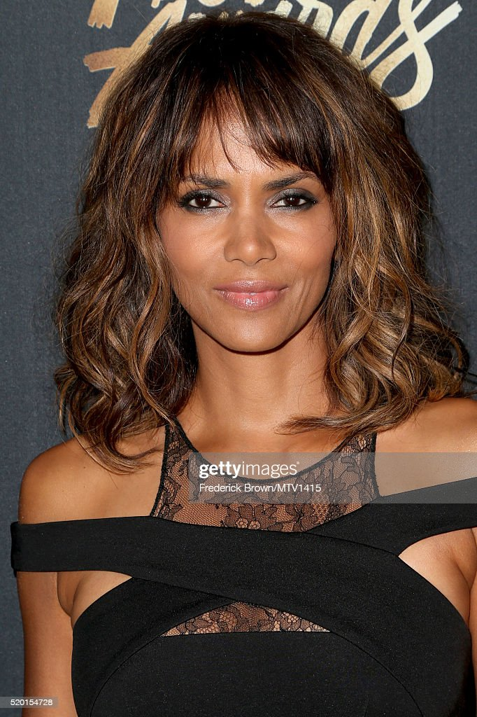 Actress <a gi-track='captionPersonalityLinkClicked' href=/galleries/search?phrase=Halle+Berry&family=editorial&specificpeople=201726 ng-click='$event.stopPropagation()'>Halle Berry</a> attends the 2016 MTV Movie Awards at Warner Bros. Studios on April 9, 2016 in Burbank, California. MTV Movie Awards airs April 10, 2016 at 8pm ET/PT.